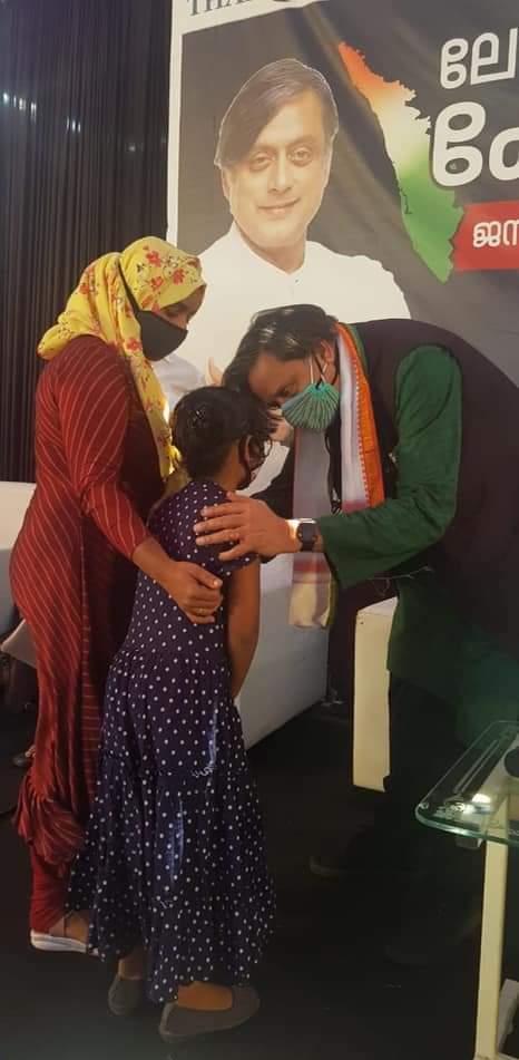 Thiruvananthapuram MP and Congress-I leader Shashi Tharoor speaks to Kappan's wife and child (Photo: Mridula Bhavani).